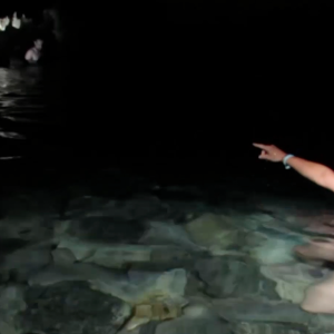pointing-in-cenote
